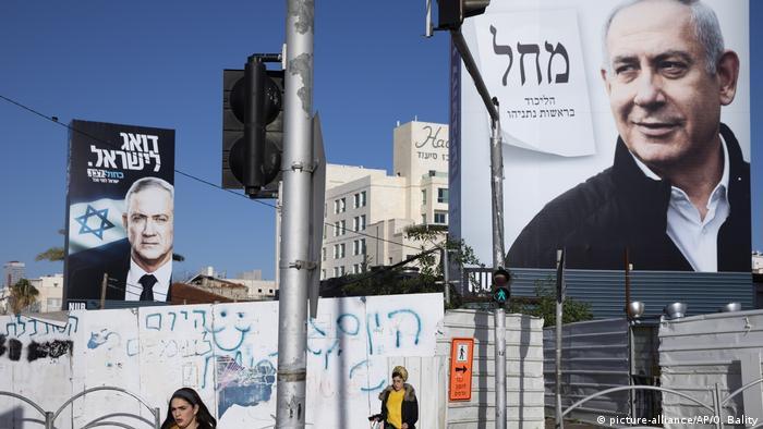 Benny Gantz and Benjamin Netanjahu seen on election poster