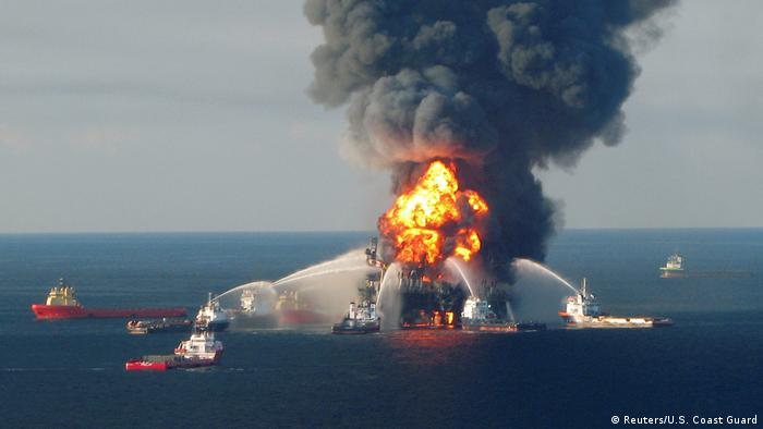 Water is sprayed on a fire on the Deepwater Horizon oil rig in 2010