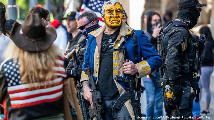 Armed protestors join hundreds of people outside the City County Building as they rally for the opening of non-life sustaining businesses in Pennsylvania on Monday, April 20, 2020