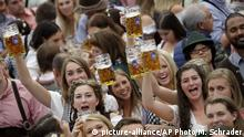 File--- In this file picture taken Sept. 22, 2018 young people celebrate the opening of the 185th 'Oktoberfest' beer festival in Munich, Germany. The world's largest beer festival will be held from Sept. 22 until Oct. 7, 2018. Bavarian state governor Markus Soeder and Munich mayor Dieter Reiter announced at a news conference that the Oktoberfest is cancelled this year because of the coronavirus outbreak. (AP Photo/Matthias Schrader, file) |