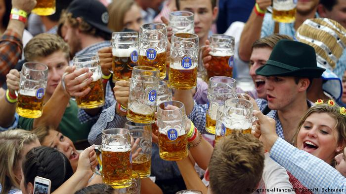 n this Sept. 19, 2015 file photo, people celebrate the opening of the 182nd Oktoberfest beer festival in Munich, southern Germany, clinking many large beer mugs together. (picture-alliance/AP Photo/M. Schrader)