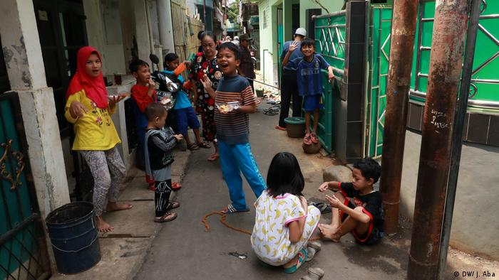 Children play togther in narrow alley in Tanah Rendah, East Jakarta
