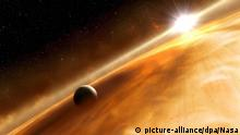 epa01550126 Artist's concept of the star Fomalhaut and the Jupiter-type planet that the Hubble Space Telescope observed. The image, released by NASA 13 November 2008, shows the newly discovered planet, Fomalhaut b, orbiting the 200-million-year-old star (every 872 years). Estimated to be no more than three times Jupiter's mass, the planet orbits the bright southern star Fomalhaut, located 25 light-years away in the constellation Piscis Australis, or the Southern Fish. Fomalhaut has been a candidate for planet hunting ever since an excess of dust was discovered around the star in the early 1980s by NASA's Infrared Astronomy Satellite, IRAS. EPA/NASA / HANDOUT EDITORIAL USE ONLY |
