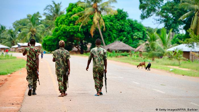 Soldiers from the Mozambican army patrol the streets after security in the area was increased, following a two-day attack from suspected islamists in October last year, on March 7, 2018 in Mocimboa da Praia, Mozambique. /