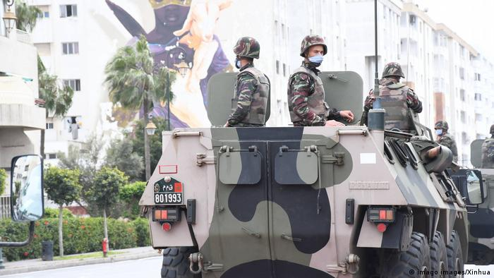 Soldiers wearing masks on an armored vehicle in Rabat