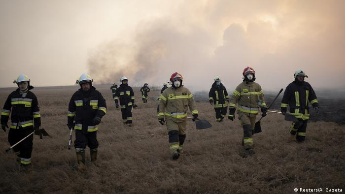 Firefighters try to extinguish a fire burning at the Biebrzanski National Park near Bialystok, Poland April 22, 2020.