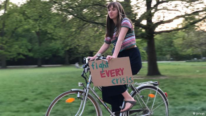 Fridays for Future activist Pauline Bünger carries her protest poster on her bicycle