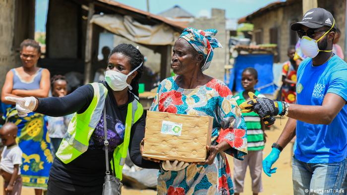 Volunteer health workers in Lagos, Nigeria, are on the streets to help distribute food