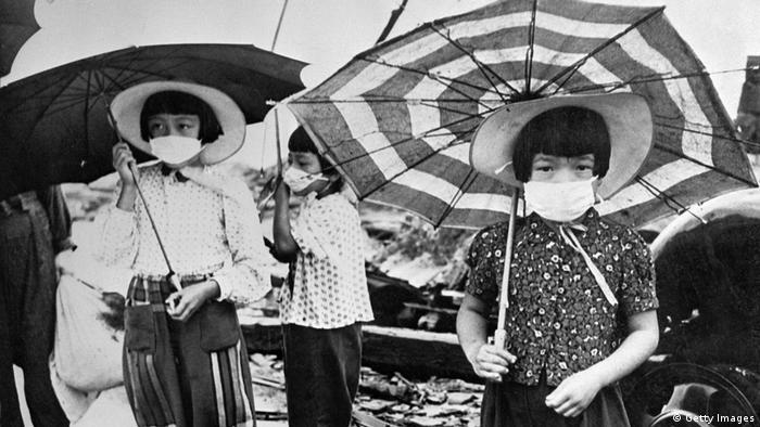 Picture from 1948 showing children wearing masks to protect themselves from irradiation in the devastated city of Hiroshima (Getty Images)
