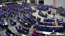 Angela Merkel addressing a very empty Bundestag in coronavirus times(Reuters/A. Hilse)