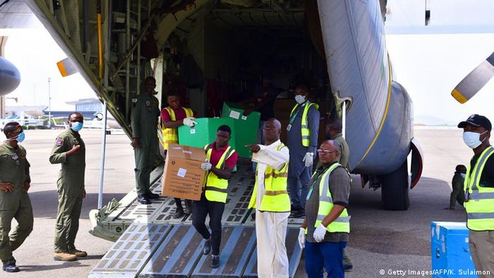 Medical supplies being carried off a plane