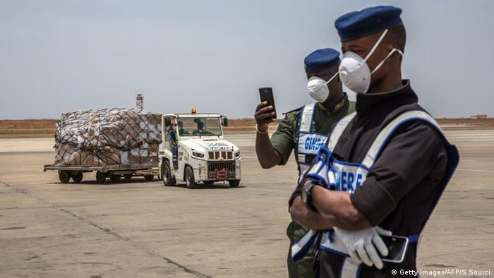A cargo of supplies to fight COVID-19 under guard on a runway in Dakar, Senegal