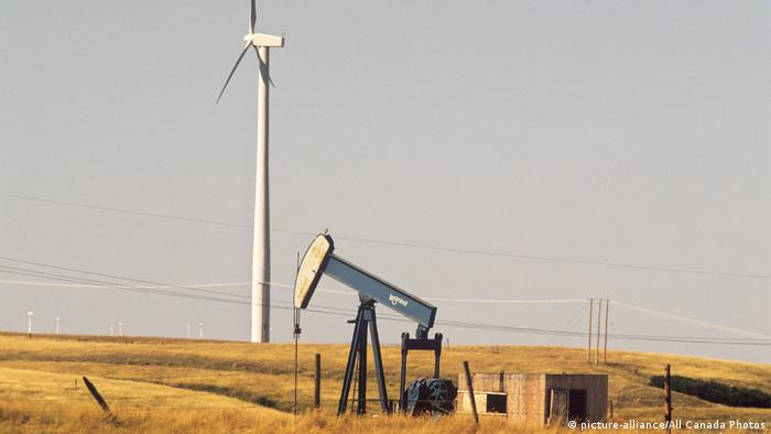 A wind turbine and an oil pump