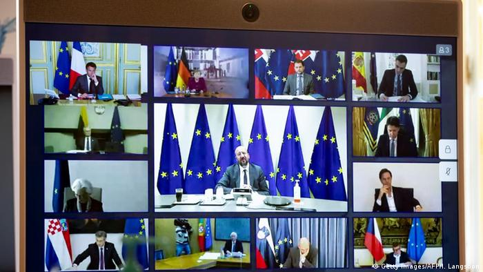 Members of the European Council are seen on the screen of a video conference call
