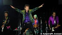 FILE PHOTO: Mick Jagger of the Rolling Stones performs with band members Keith Richards, Charlie Watts and Ronnie Wood during their No Filter U.S. Tour at Rose Bowl Stadium in Pasadena, California, U.S., August 22, 2019. REUTERS/Mario Anzuoni/File Photo