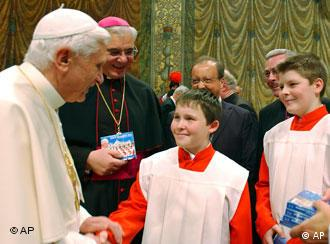 Pope Benedict XVI greets youths of the Regensburger Domspatzen boy's choir at the Vatican