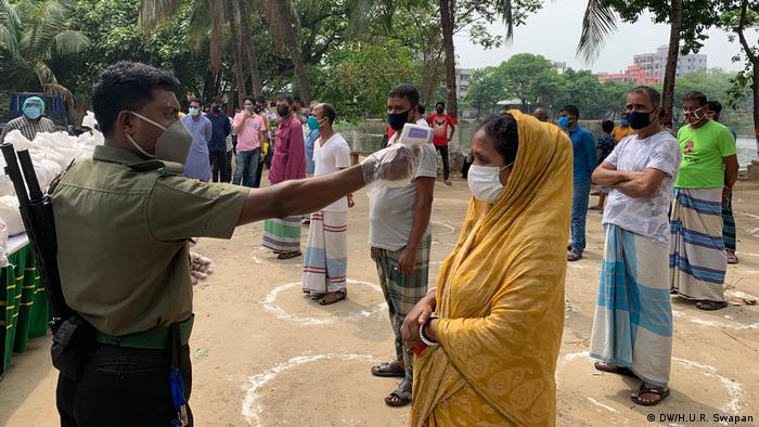 People in Dhaka, Bangladesh are required to maintain social distance in public places to slow the spread of coronavirus