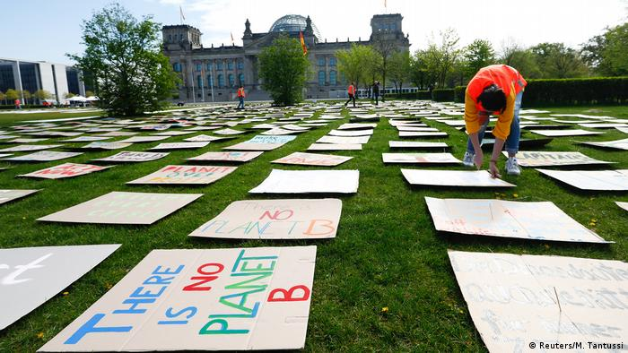 Activists of the Fridays for Future movement prepare a protest in front of the Reichstag building, the seat of the lower house of parliament Bundestag, as the spread of the coronavirus disease