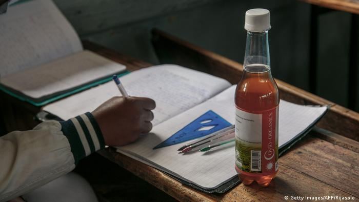 A bottle of Covid Organics, a herbal tea touted by Madagascar's president, Andry Rajoelina