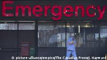THE CANADIAN PRESS 2020-03-30. A health care worker is seen outside the emergency department of the Vancouver General Hospital in Vancouver on March 30, 2020. Hospitals facing urgent COVID-19 needs are banding together to close funding gaps for their institutions and embattled health-care workers. Dubbed The Frontline Fund, the national campaign seeks donations on behalf of more than 100 institutions across the country for supplies, staff support and research. Organizers say the money would help hospitals source personal protective equipment and ventilators, fund drug trials and vaccine research, and provide mental health support to exhausted staff. Ten per cent of funds will also go towards the northern territories and Indigenous health. THE CANADIAN PRESS/Jonathan Hayward URN:53485226 |