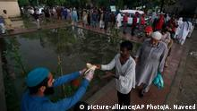 People get free food provided by the Saylani Welfare Trust to break their fast on the first day of Ramadan, in Islamabad, Pakistan. Saturday, April 25, 2020. Millions of Muslims have started Ramadan, the holiest month on the Islamic calendar, under the coronavirus lockdown or strict social restrictions. (AP Photo/Anjum Naveed)