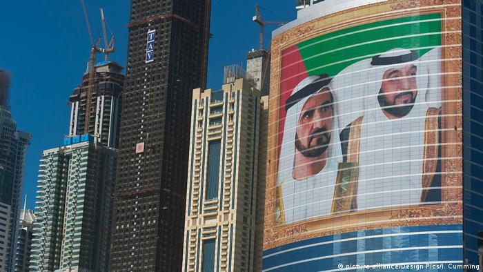 Portraits of UAE President Khalifa bin Zayed Al Nahyan and Dubai Sheikh Mohammed bin Rashid Al Maktoum on an office building