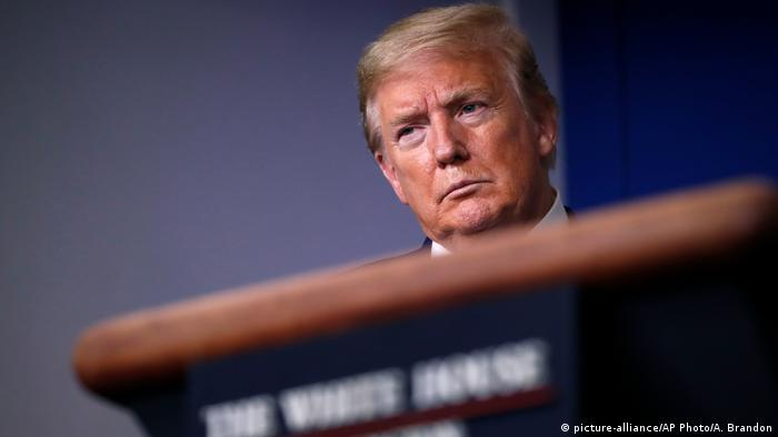 US President Donald Trump listens during a briefing about the coronavirus in the James Brady Press Briefing Room of the White House, in Washington DC.