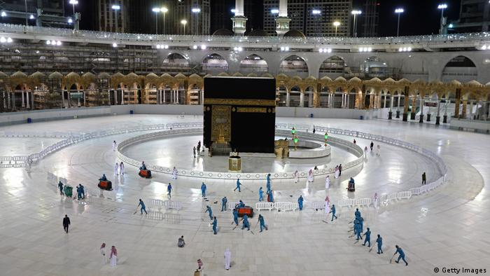 Sanitation workers disinfecting the area around the Kaaba in Mecca's Grand Mosque as a result of the coronavirus pandemic