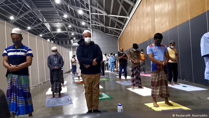 Muslim patients perform Ramadan prayers at the Singapore Expo Convention Hall and Exhibition Centre, which has been converted into a facility for patients recovering from the coronavirus disease (COVID-19), in Singapore, April 24, 2020.