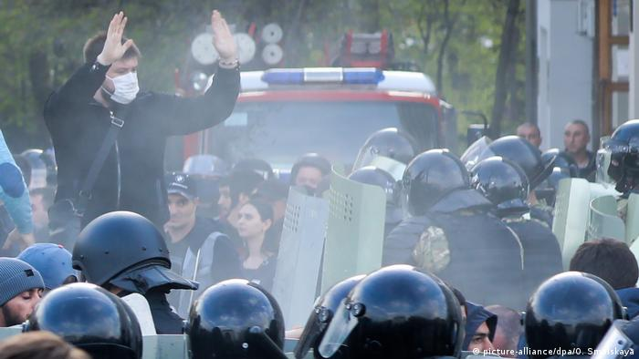 Police and protesters at a rally in North Ossetia