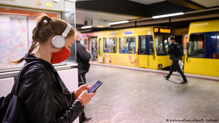 A woman standing on an underground train platform in the German city of Stuttgart wearing a coronavirus protection fabric face mask during the COVID-19 global pandemic