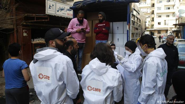 CARE staff fill vans with food parcels and hygiene items to distribute to families in Tripoli during the coronavirus pandemic