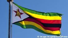 March 29, 2011 - Kazungula, Zimbabwe - The flag of Zimbabwe flying at the Kazungula Border Post. PUBLICATIONxINxGERxSUIxAUTxONLY - ZUMAd84_ March 29 2011 Kazungula Zimbabwe The Flag of Zimbabwe Flying AT The Kazungula Border Post PUBLICATIONxINxGERxSUIxAUTxONLY ZUMAd84_
