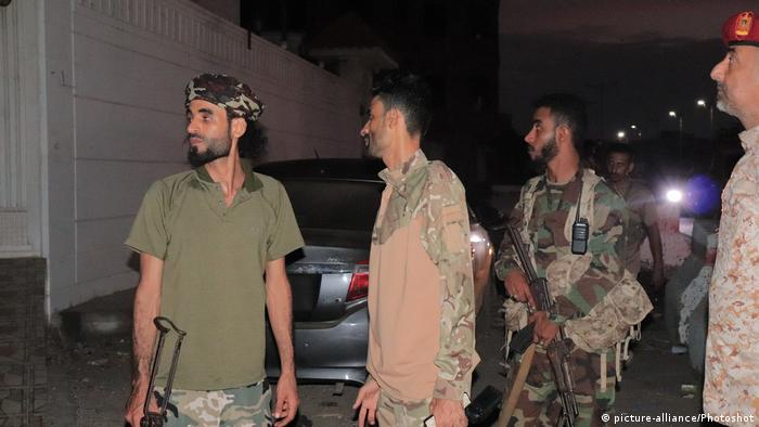 Members of Yemen's Southern Transitional Council forces are seen in Aden carrying weapons
