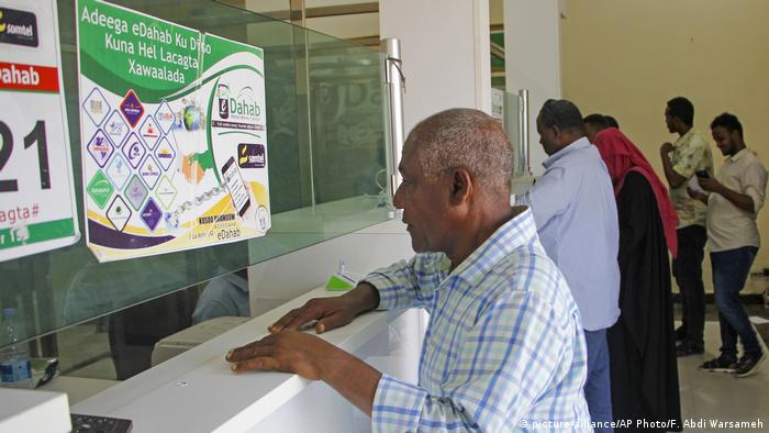 A man in Somalia waits to receive a money transfer