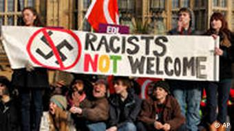 Anti-fascist demonstrators react to supporters of the English Defence League across the street gathering in support of the visit of controversial Dutch politician Geert Wilders in London