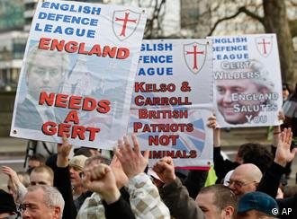 Supporters of the English Defence League gather outside Tate Britain for a march to the Houses of Parliament in support of right-wing Dutch MP Geert Wilders who is visiting the House of Lords, London, Friday, March 5, 2010. (AP Photo/Sang Tan)