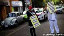 Healthcare workers stop the vehicle traffic in a protest to demand personal protective equipment at Tacuba General Hospital, as the spread of the coronavirus disease (COVID-19) continues, in Mexico City, Mexico April 21, 2020. The placards read: Make tests of coronavirus disease (COVID-19) to medical personnel and Make tests of coronavirus disease (COVID-19) to patients before admitting them in the COVID-19 area. REUTERS/Edgard Garrido
