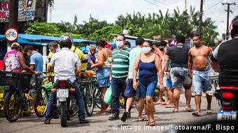 People walk through a market in Belem