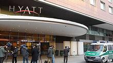Police and media stand in front of the Hyatt Hotel at Potsdamer Platz in Berlin, Saturday, March 6, 2010, after group of armed men heist a poker tournament at the hotel.(AP Photo/Markus Schreiber)