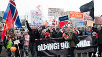 Protesters march to the parliament in Reykjavik to protest ahead of the referendum