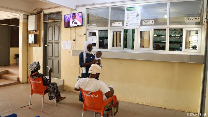 People wait at the SDA hospital in Tamale, Ghana