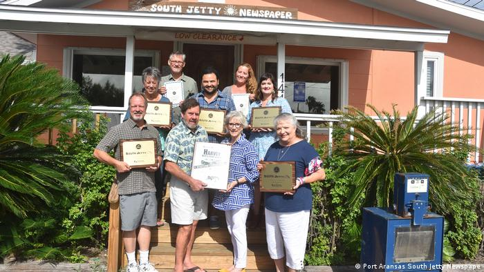 Members of the South Jetty staff pose outside its office in Texas (Port Aransas South Jetty Newspape)
