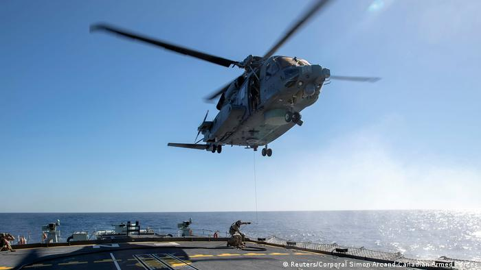 Archive image from February 15, 2020 of a CH-148 Cyclone helicopter above the HMCS Fredericton