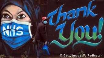 Мужчина в маске в Лондоне