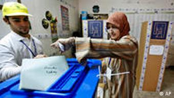 A woman casts her vote in Baghdad