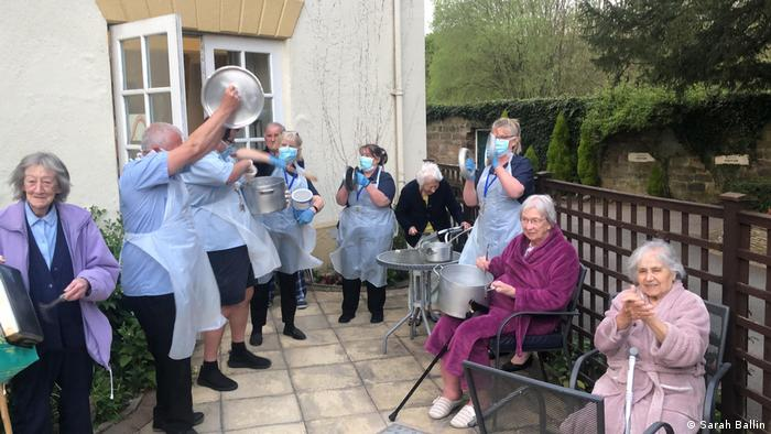 Residents and care workers outside Coxbench Hall care home in Derbyshire