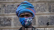 Kenyan fashion designer of Lookslikeavido, David Avido, 24, poses for a portrait at his studio in Kibera, Nairobi, on March 18, 2020, with a mask he made, that he creates from remnant of cloth he uses, to hand out to people for free so that they can wear it as a preventive measure against the COVID-19 coronavirus. (Photo by Gordwin ODHIAMBO / AFP) (Photo by GORDWIN ODHIAMBO/AFP via Getty Images)