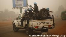 MINUSCA UN forces from Rwanda patrol the streets of Bangui, Central African Republic, Friday Feb. 12, 2016. Two former prime ministers, Faustin Archange Touadera and Anicet Georges Dologuele , are running neck-and-neck in the second round of presidential elections Sunday Feb. 14 to end years of violence pitting Muslims against Christians in the Central African Republic. (AP Photo/Jerome Delay) |