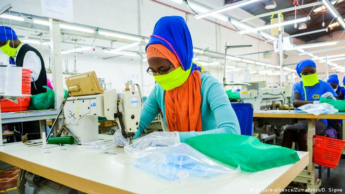 An employee at Shona EPZ Limited sewing face masks (SOPA Images/D. Sigwe)